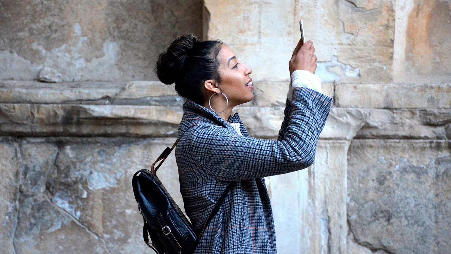 woman taking a photo with her phone